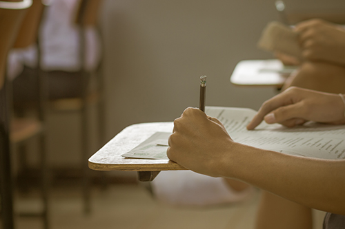 students writing a test in their exercise, exam multi-choice in