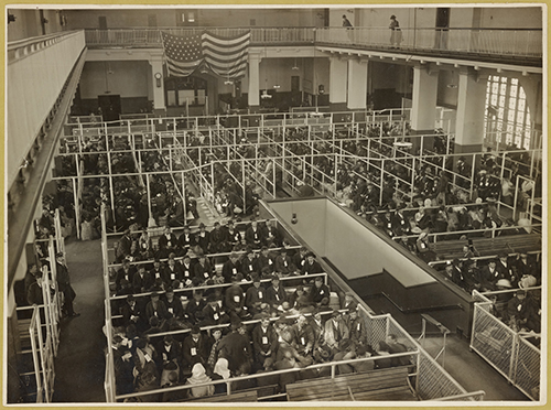 nypl.digitalcollections.The pens at Ellis Island, Registry Room (or Great Hall). These people have passed the first mental inspection.(500)
